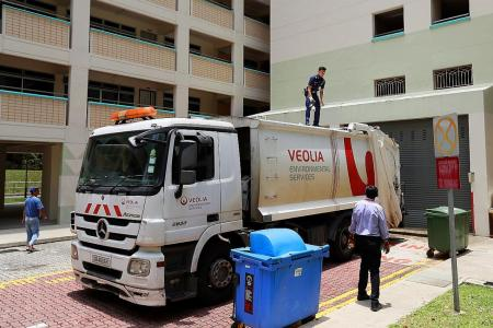 Man found dead after falling on top of garbage truck