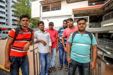 Jobless and unpaid, foreign workers face daunting future