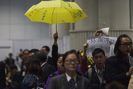 Hong Kong cops target activists