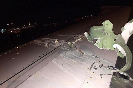 Wings of planes collide at Changi
