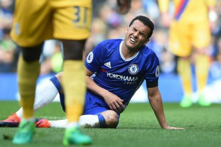 Chelsea's Pedro reacts after missing an opportunity to score