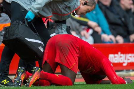 Liverpool's Sadio Mane tried to walk off but collapsed on the touchline before being substituted due to an injury