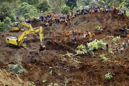 At least two dead after landslide in East Java