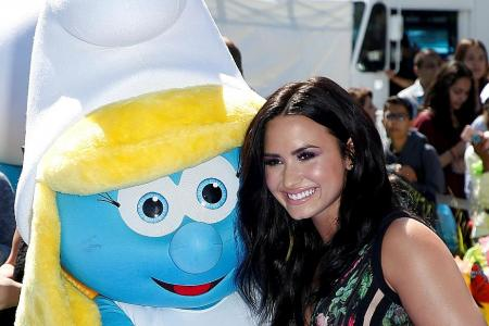 Demi Lovato returns to her roots in new Smurfs film