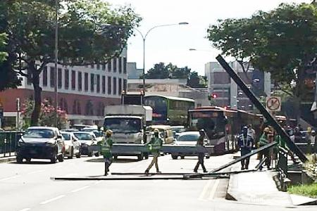 Metal beams fall onto busy Balestier Road