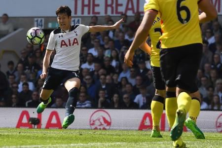 Tottenham Hotspur's South Korean striker Son Heung-Min (L) prpepares to volley the ball to score his team's fourth, and his second goal against Watford