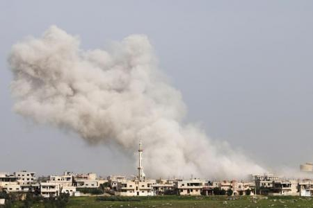 Smoke billows following a reported air strike on a rebel-held area in the southern Syrian city of Daraa