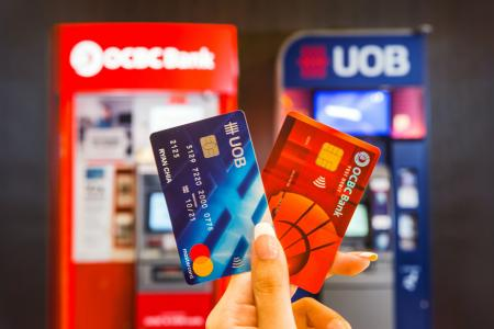 UOB, OCBC customers get free withdrawals from either bank's ATMs
