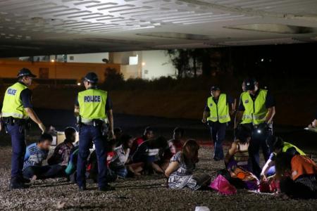 13 nabbed in anti-vice raid at Kaki Bukit forested area