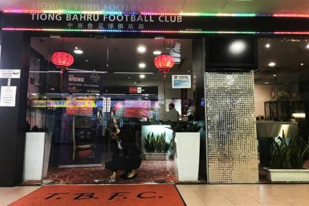 A member of staff of Tiong Bahru FC's clubhouse locking the premises some 30 mins after four individuals entered the club