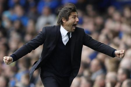 Chelsea manager Antonio Conte celebrates after Gary Cahill scores their second goal