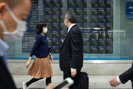 Asian stocks edge up as US dollar regains traction