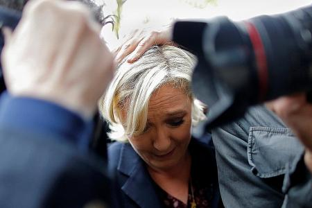 Protesters hurl eggs at French presidential candidate Marine Le Pen at campaign stop