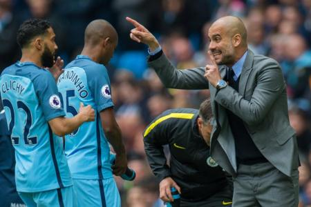 Manchester City manager Pep Guardiola gives out instructions during the match against Crystal Palace
