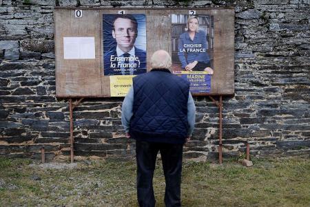 Macron, Le Pen face off as France decides