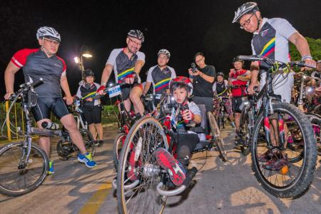 He raises $11,000 by handcycling 25km