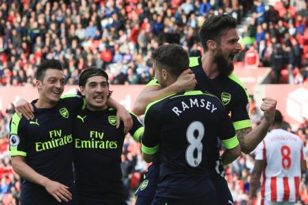 Arsenal manager Wenger happy with fighting spirit