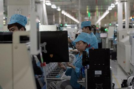 China factory output slows in April, as credit tightens