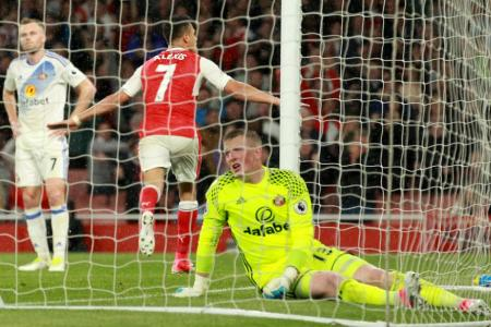Arsenal's Chilean striker Alexis Sanchez celebrates scoring the second goal during the English Premier League football match between Arsenal and Sunderland