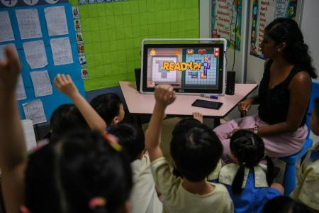 Pre-schoolers learn about coding on tablet games