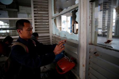 Indonesia probes suicide bombings that killed three policemen