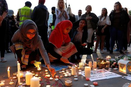 Manchester shows defiance and strength at town hall vigil