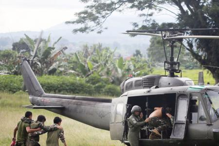 Helicopters, tanks in battle to retake Philippine city