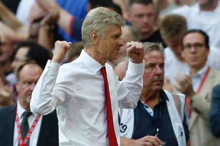 Arsene Wenger celebrates at the final whistle in the FA Cup final