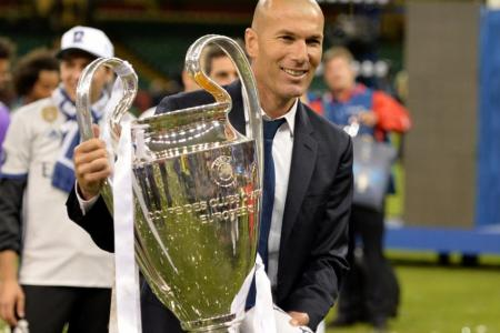 Zinedine Zidane celebrates with the trophy after the UEFA Champions League final