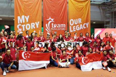 Minister for Culture, Community and Youth Grace Fu (centre, in white pants) poses with able-bodied and para-athletes at the Team Singapore camp at the Singapore Sports Institute in Kallang on Saturday, after launching the #OneTeamSG Ready for KL campaign.