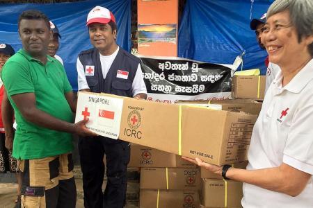 Red Cross volunteers help flood-hit Sri Lanka
