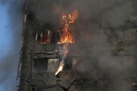 Were fire barriers installed in London tower?