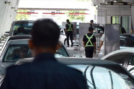 Two AETOS officers arrested under ISA, one planned to fight in Syria