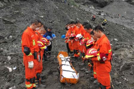 Rescuers told to evacuate due to risk of second landslide