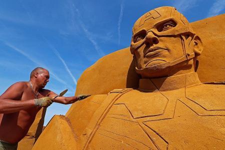 Sand sculpture festival brings superheroes to Belgian beach