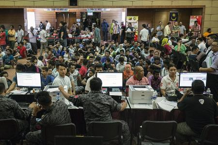 Illegal workers arrested in raids across Malaysia
