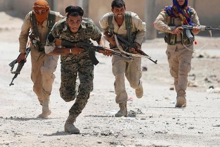 'Key milestone' reached in Raqqa