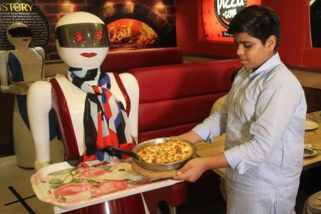 Robot waitresses rolling in the dough