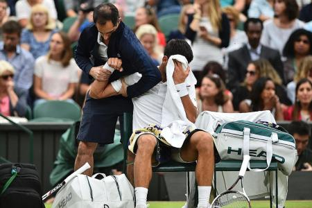 Novak overcomes injury scare to reach q-finals