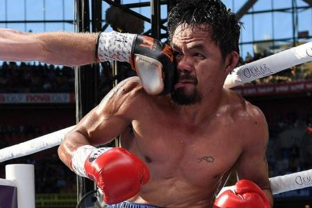 Pacquiao vows to continue fighting despite controversial loss