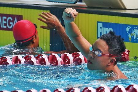 Swimmer Mikkel makes a splash with golden double