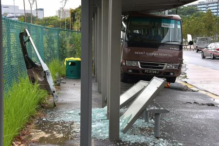 13 hurt after bus crashes into bus stop