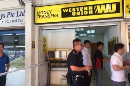 JUST IN: Armed robber still at large at Ubi Avenue