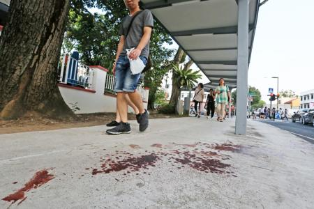The blood trail left by the victim stretched for 5m along a sheltered walkway at the junction of Sims Avenue