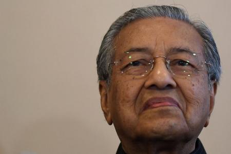 Mahathir's sons' companies raided by tax authorities