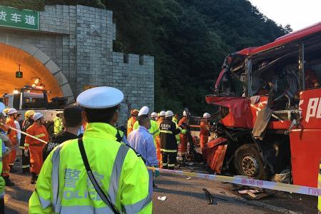 China bus slams into wall, killing 36