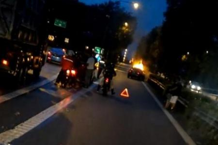 Two injured, car catches fire in SLE accident