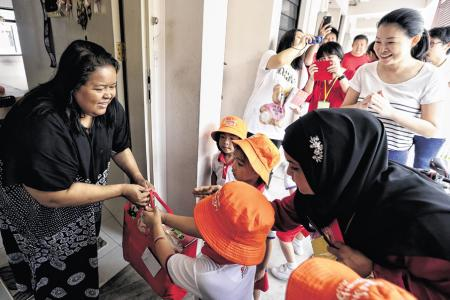 Tampines pre-schoolers mix chores with charity