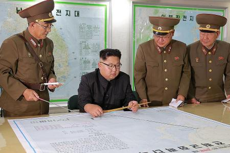 Kim Jong Un holds off on missile plans