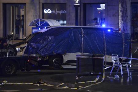 Catalan president warns Spain attack suspect still at large